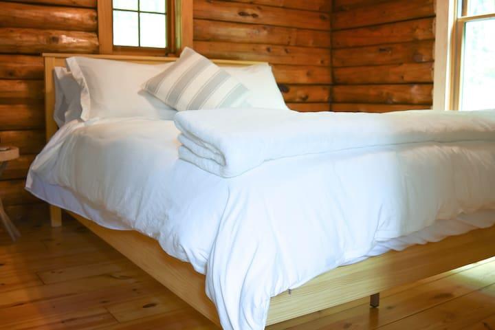 """Main floor Queen Bedroom called the """"Oak"""" room."""