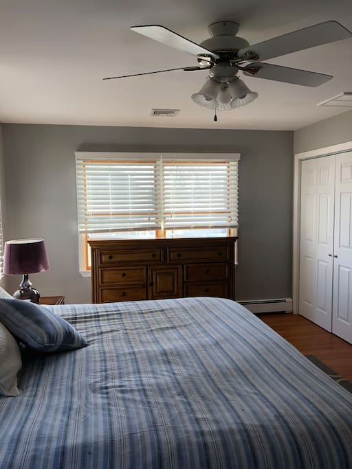 Master Bedroom. King size bed. Walk in closet and regular size closet. Ceiling fan. Central air thermostat upstairs.