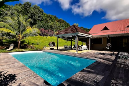 Private room in a house, tropical garden and pool