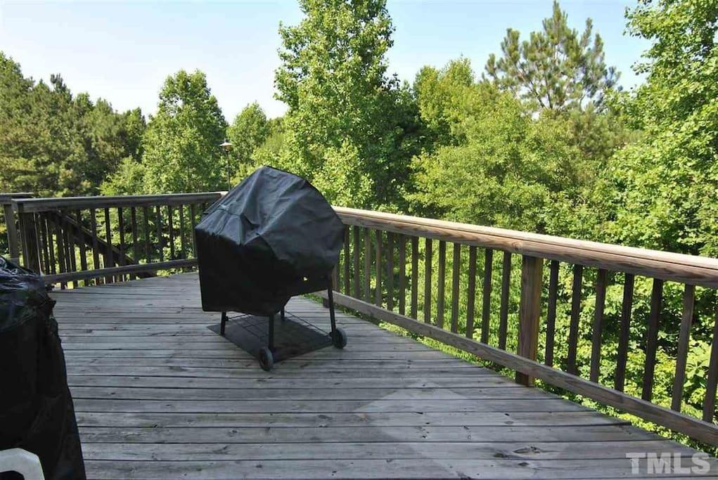 Spacious Back Deck for Relaxing and enjoying a wooded view.