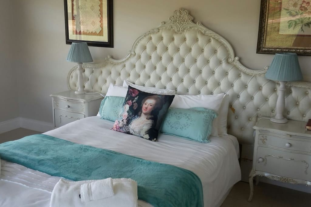 Spacious bedroom with Queen-size bed and dressing table