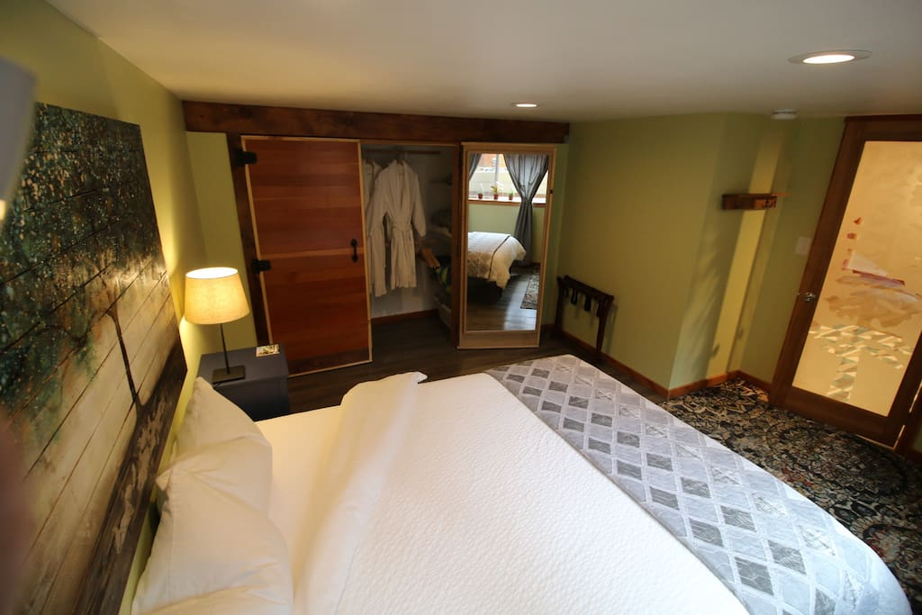 Master suite with comfortable queen-sized mattress. Closet is always stocked with additional pillows for all firmness levels, additional cozy blankets, and additional linens.