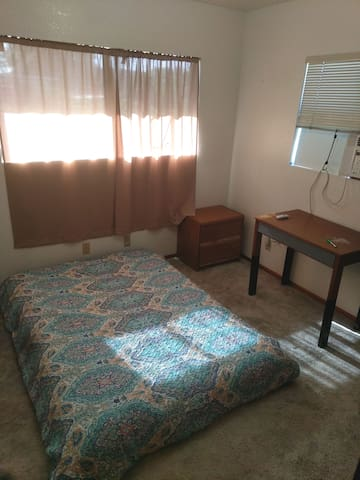Centrally located room with private bathroom & A/C