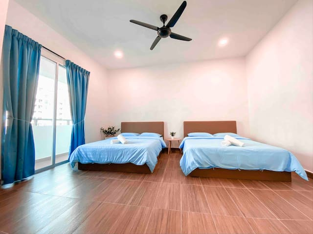 Master bedroom with two queen size beds and ceiling fan. We do provide hair dryer.