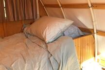 Single bed in the sheep herder's wagon camper. Tall people sleep diagonally!