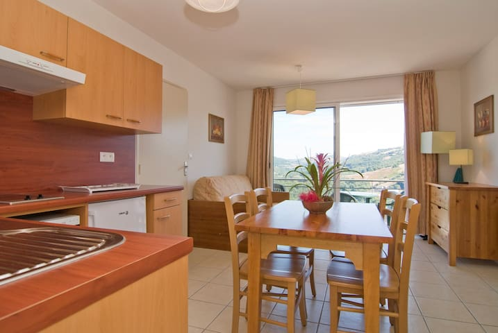 Prepare a meal in the kitchenette and enjoy your food at the dining table.
