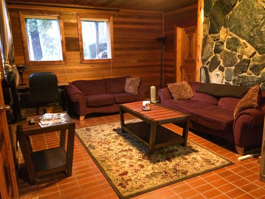 Flat screen tv, writing desk, and two sofas make for comfortable relaxation.