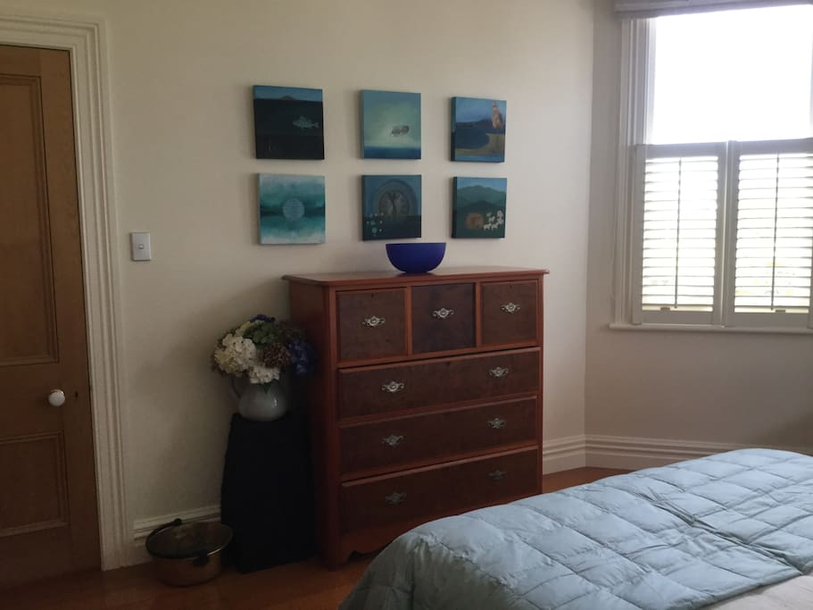 Original artworks and antique scotch dresser.