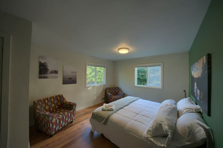 Master bedroom with cozy Herman Miller chairs