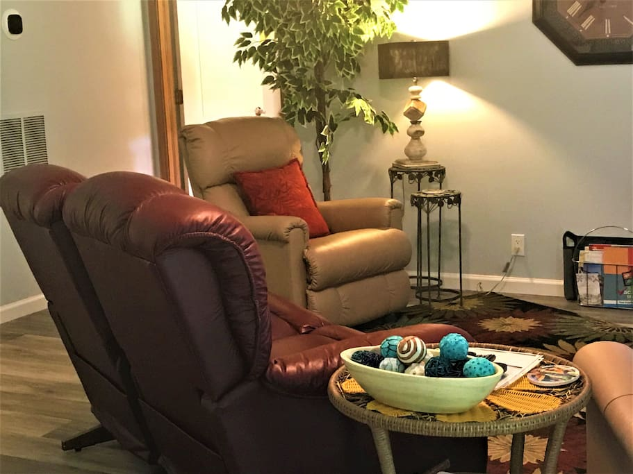Sit in the leather love seat double recliner or in one of 2 additional leather recliners and watch the 55in. HD flat screen TV!!