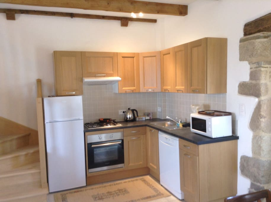 Kitchen with oven, dishwasher, microwave etc.