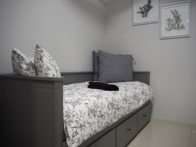 """Second bedroom comes with Day bed convertible into a queen size bed. The 2nd bedroom can be """"close up"""" via sliding doors for privacy."""