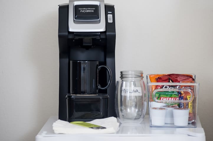 Keurig coffee maker with starbucks and donut shop coffee pods. mini with snacks, fruit, juice, H2O and beer. tips appreciated for restocking.