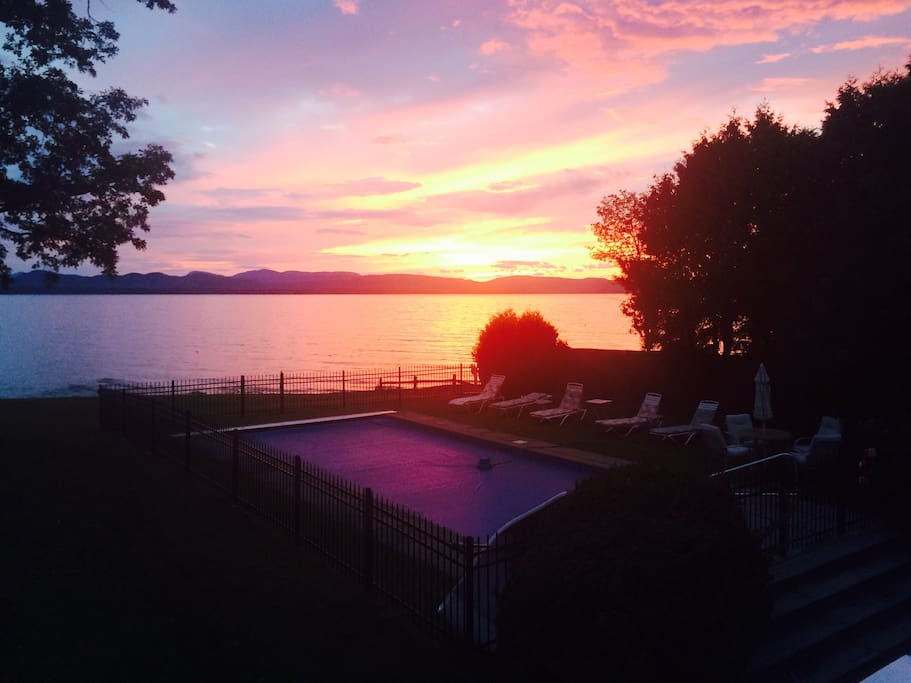 Sunset over pool and lake
