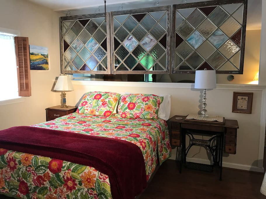 Comfortable queen bed, dresser and large closet.  100 year old stained glass windows separate rooms. Access to the bathroom from the bedroom suite.