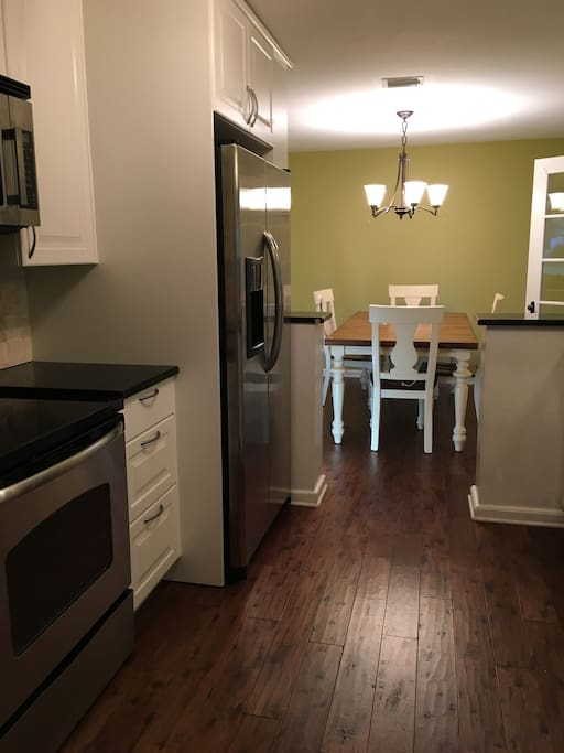 newly renovated kitchen with brand new dinning room