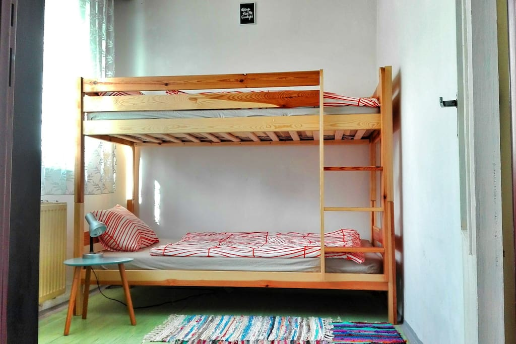 Bedroom with bunk bed and cupboard