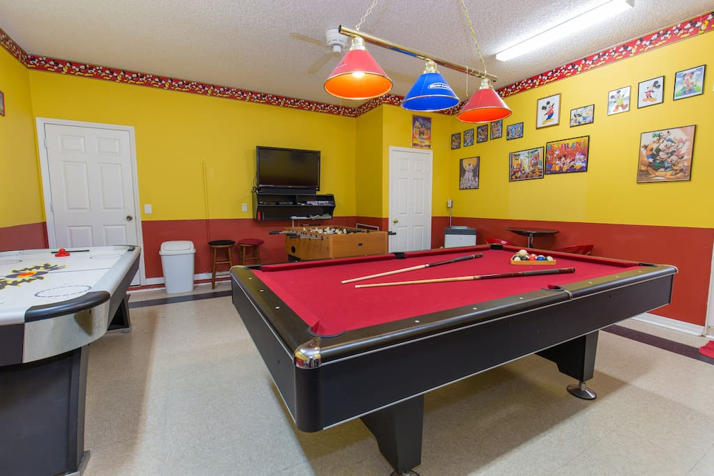 Game-room has pool table, air-hockey and table football able