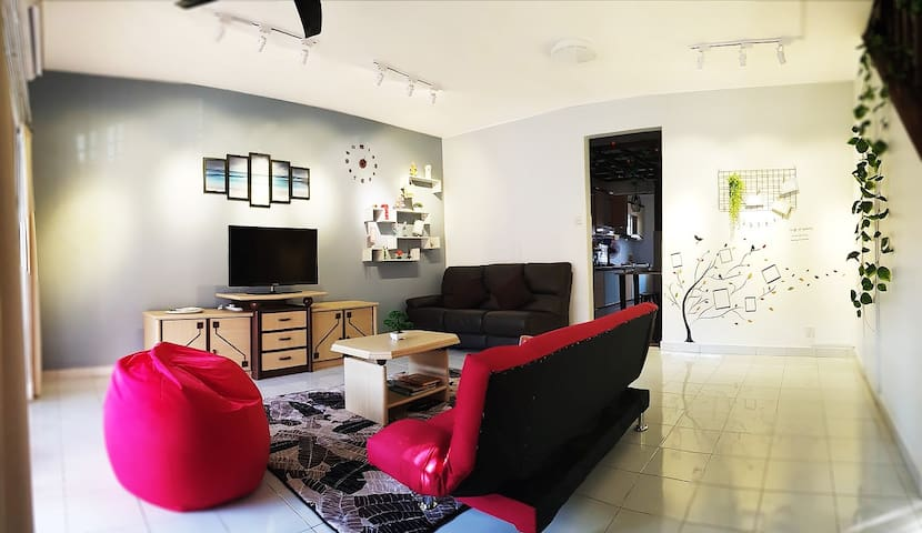 3 - Livingroom with aircond, beanbag, sofabed, 3seater sofa, coffeetable, TV and ceiling fan