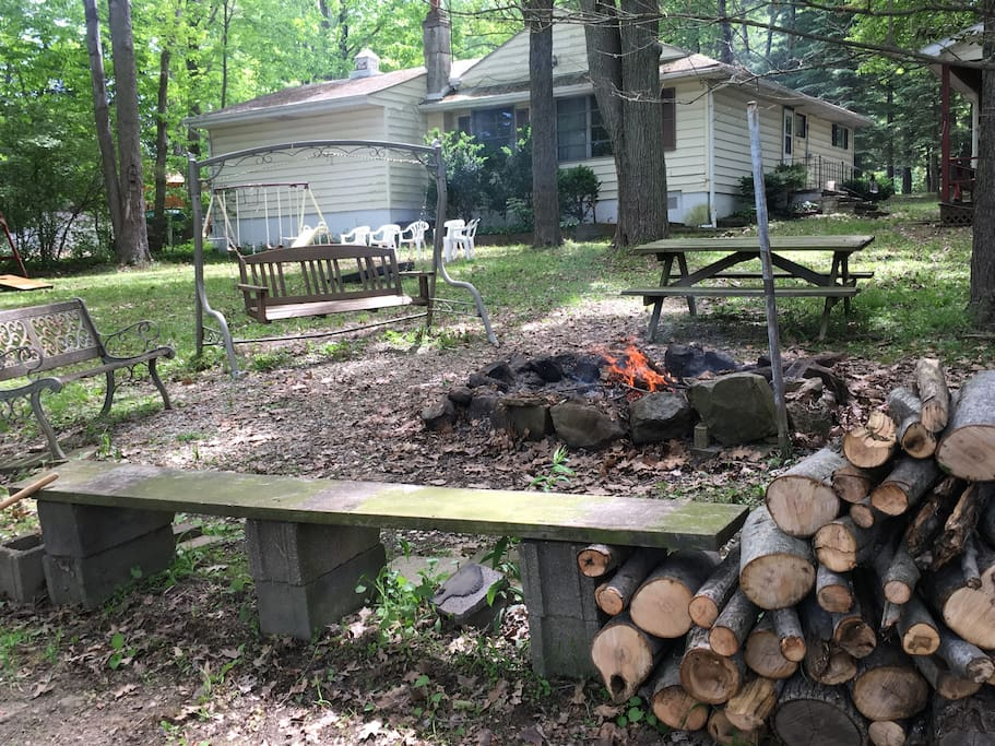 Fire pit with plenty of wood and seating great for roasting marshmallows and S'mores.