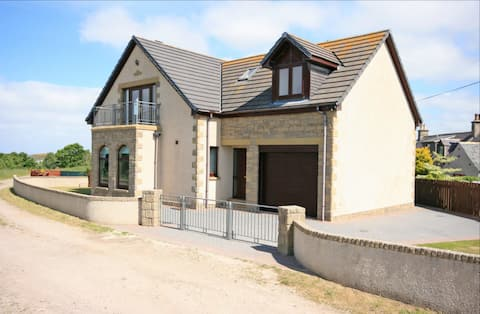 Villa with balcony overlooking the Moray Firth