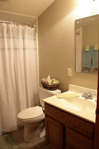 Sparkling clean full bath with quality towels, hair dryer, and little necessities that you may have forgotten.
