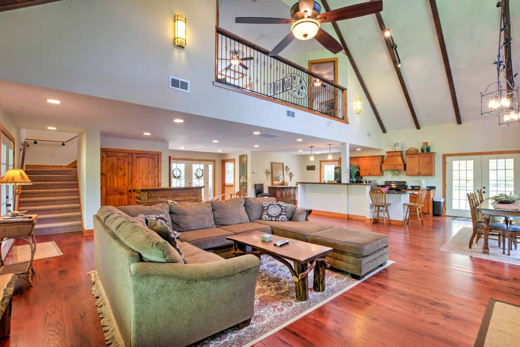 The interior features a spacious open layout and cathedral ceilings.