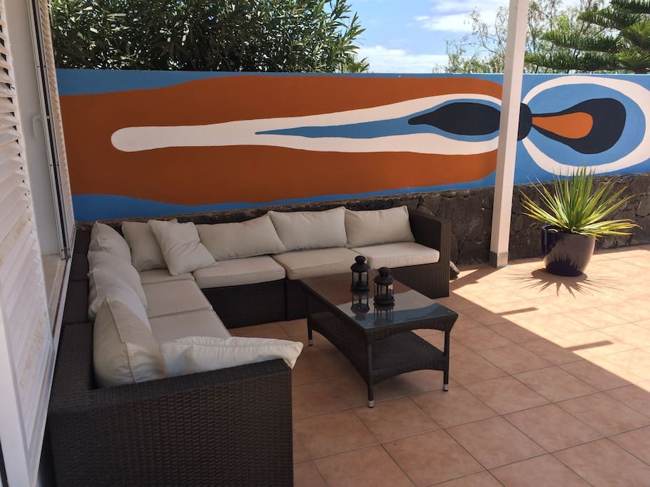 Sit outside in the shade while watching The sea and Fuerteventura island