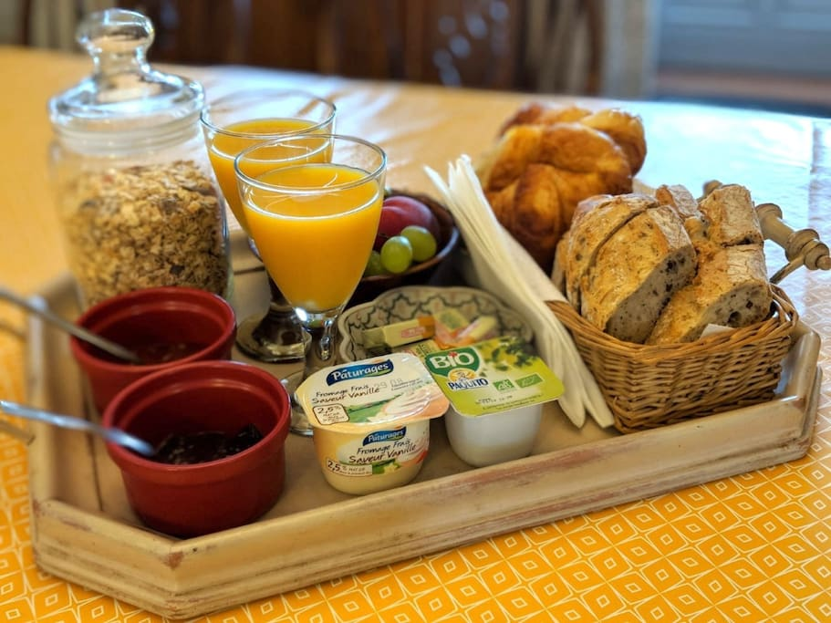 Breakfast for two including fresh croissants and bread from the local bakery, a selection of homemade jams, muesli, yogurts and fresh fruit