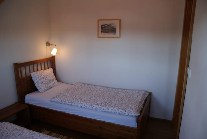 Podkrovní apartmán v rodinném penzionu Oloffson