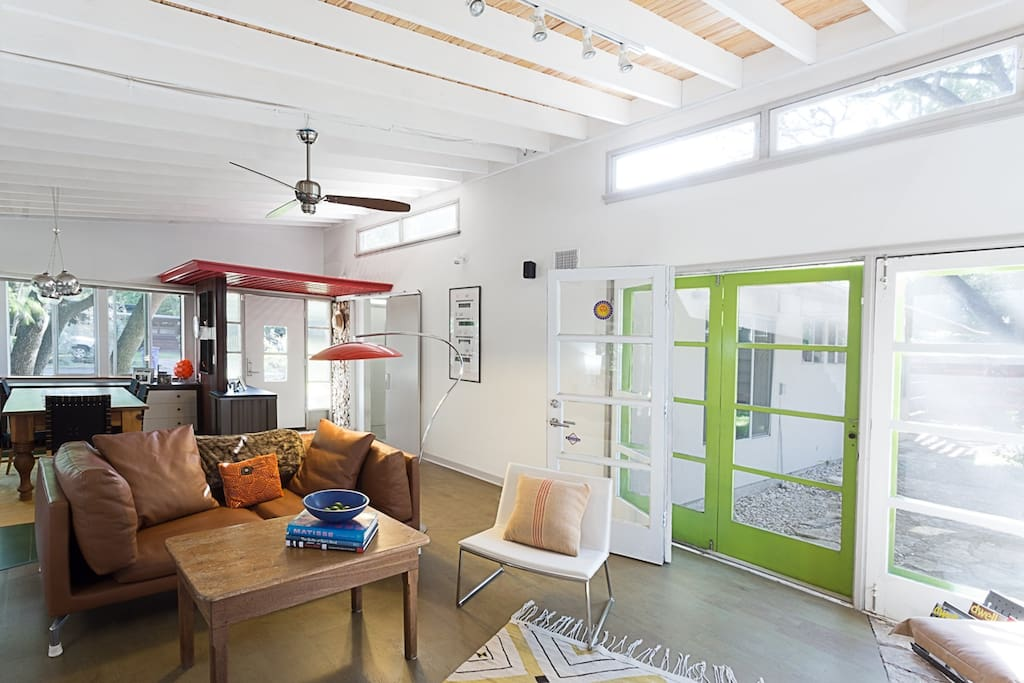 Vaulted living/dining with double French doors to patio