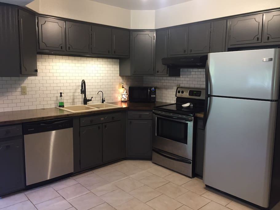 Full, well lit kitchen with newer appliances for all your cooking needs.