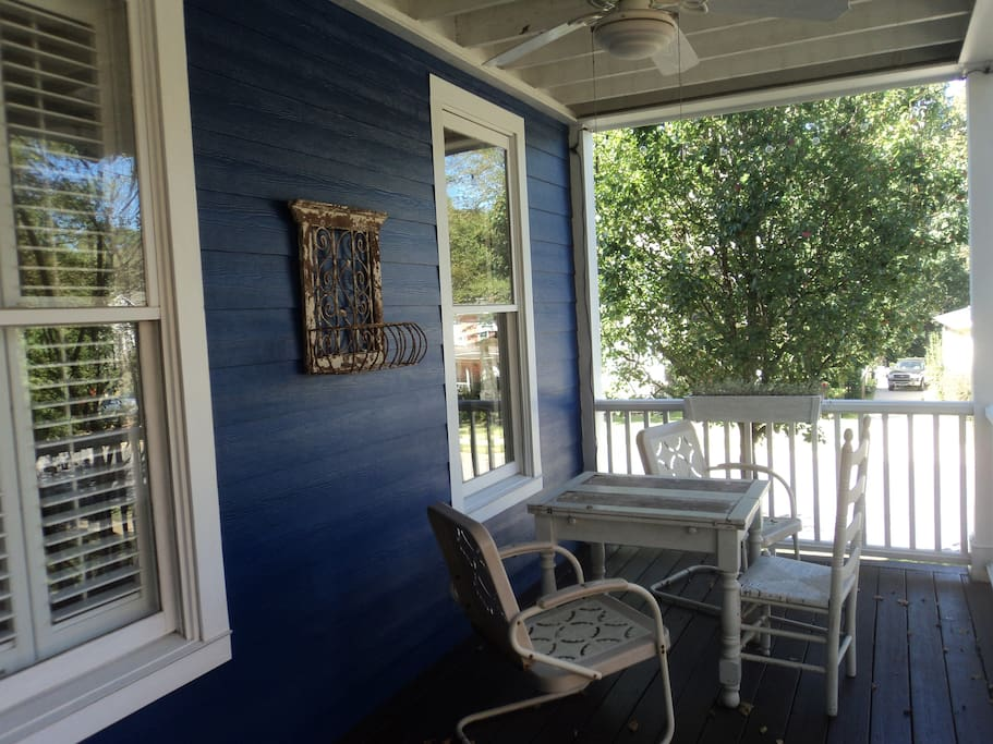 The front porch is a delightful place to visit with family and friends!