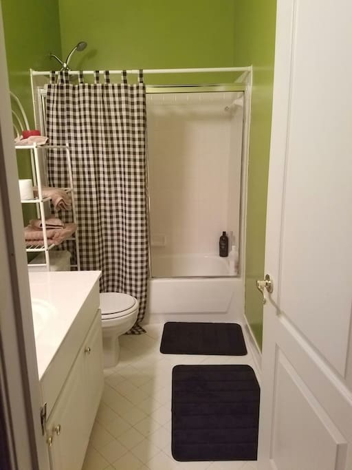 Clean bathroom with fresh paint, shared with upstairs guest