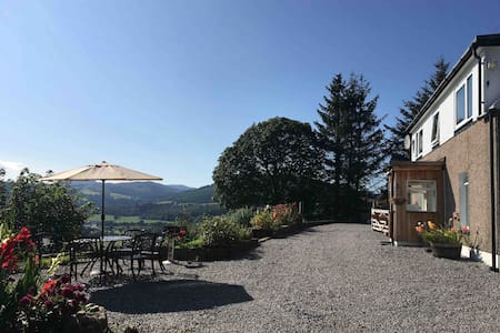 Rural retreat with log fire, loch views & garden