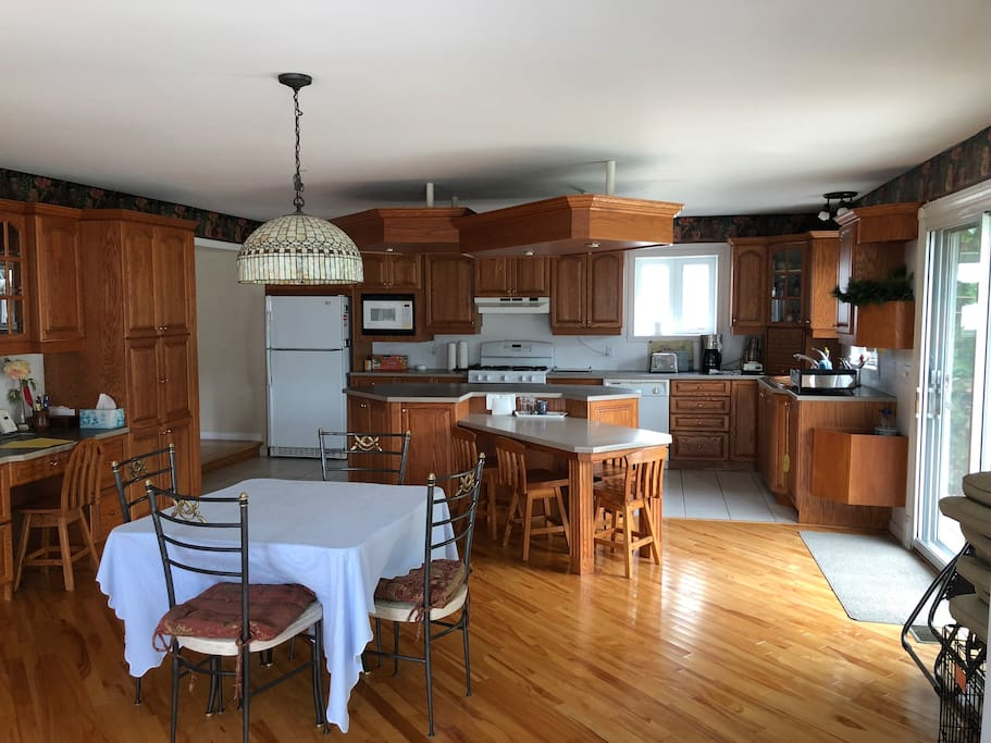 very large kitchen with two tables