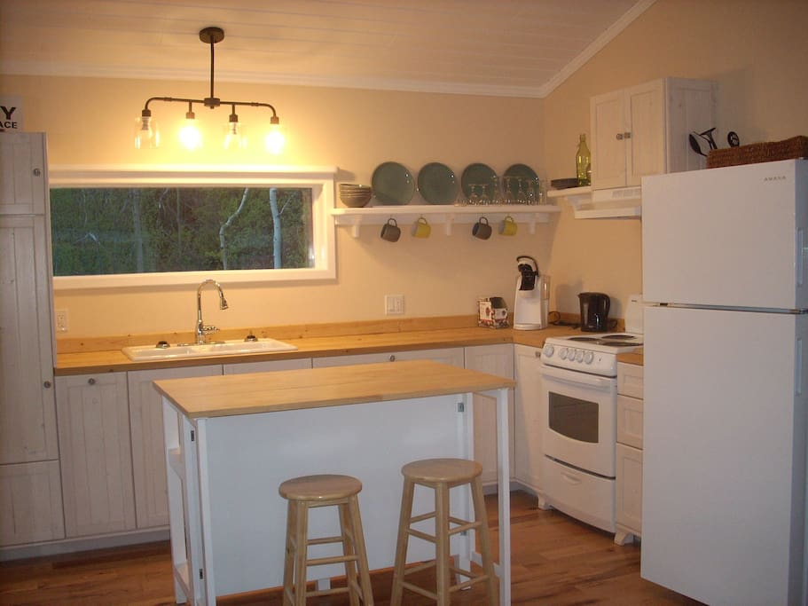 New, fully equipped Cape Cod kitchen with oak floors