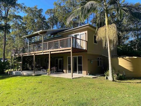 Lake MacDonald acreage retreat w/outdoor living