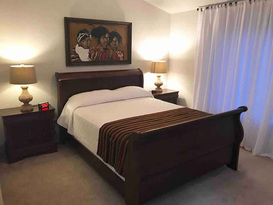 The second bedroom has a queen size bed, two nightstands and a large dresser.