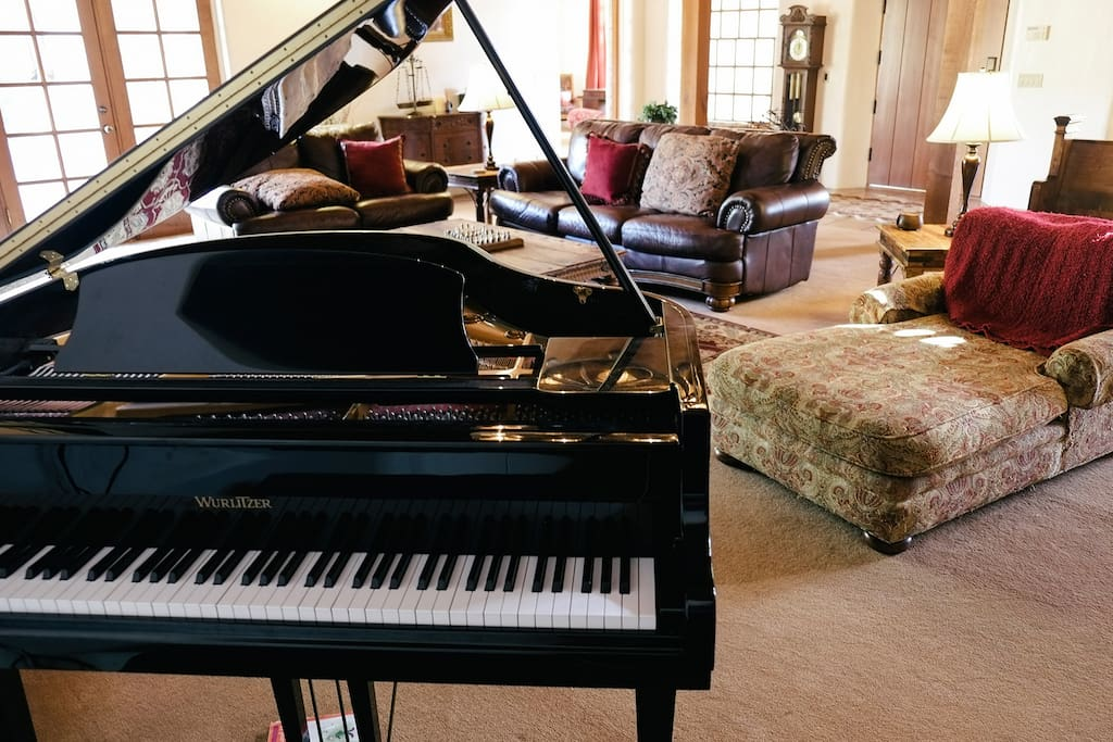 Piano in Great Room by Loft Stairs