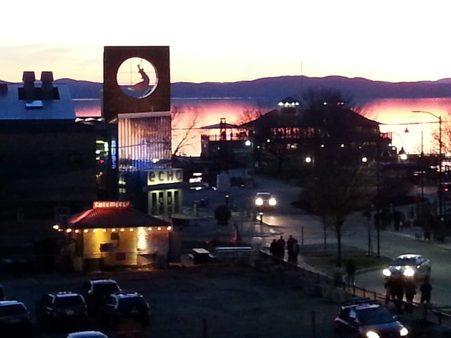 Travel 70 minutes to Burlington Vermont and experience The ECHO -Leahy Centre for Lake Champlain the interactive science centre and aquarium seen here at twilight with the Adirondack Mountains of New York in the background.