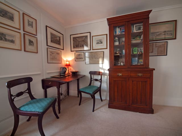 Table, chairs and cabinet