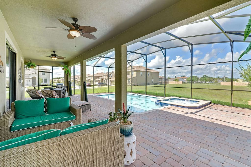 Relax under the shade and truly live the Florida lifestyle while on vacation in this stunning family vacation home.