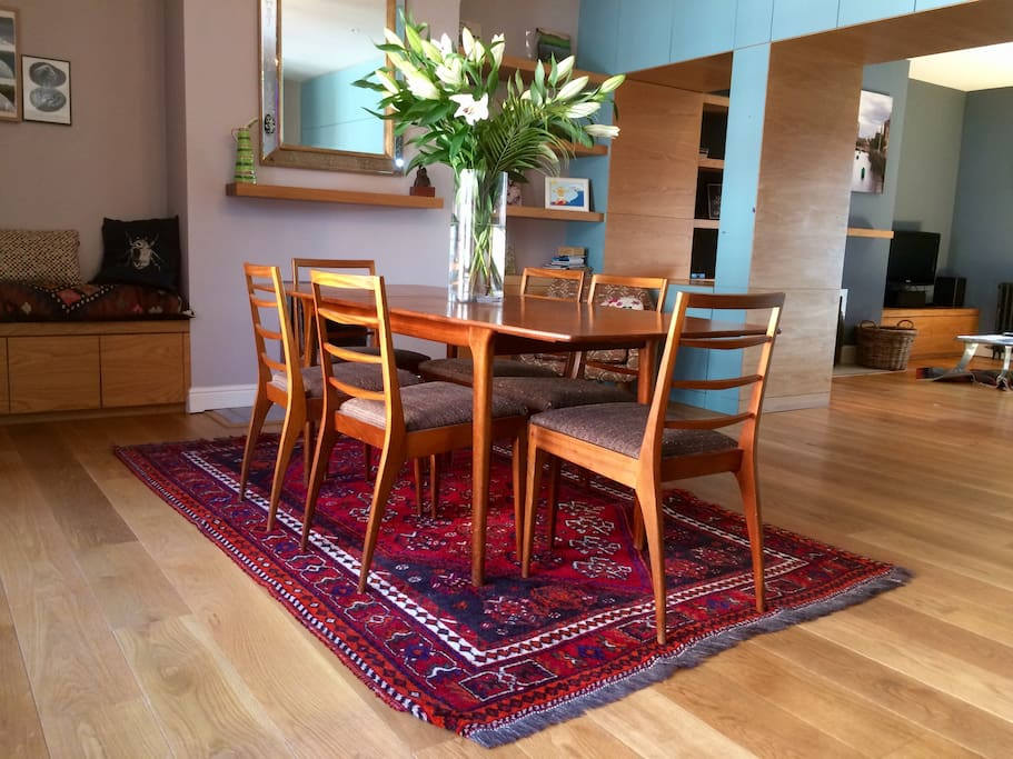 Our mid-century Danish dining table seats 6 and if you're too exhausted to cook grab some take-out from the wonderful food hall across the road.