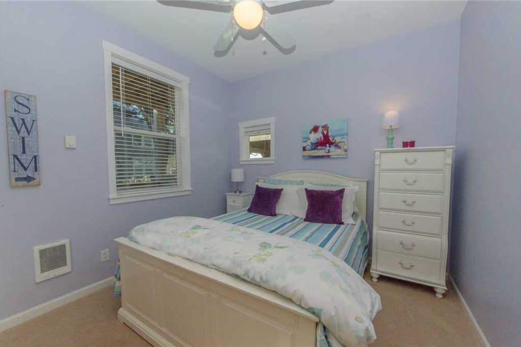 Walk into the home and you will find the first bedroom.