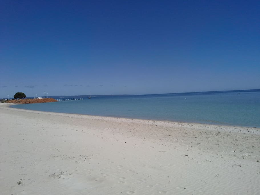The beach in front of the home
