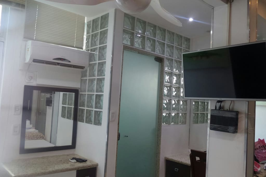 View of room showing Bathroom and TV.