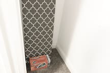 The closet in the Red Floral bedroom has a full-size ironing board and steam iron for your convenience!