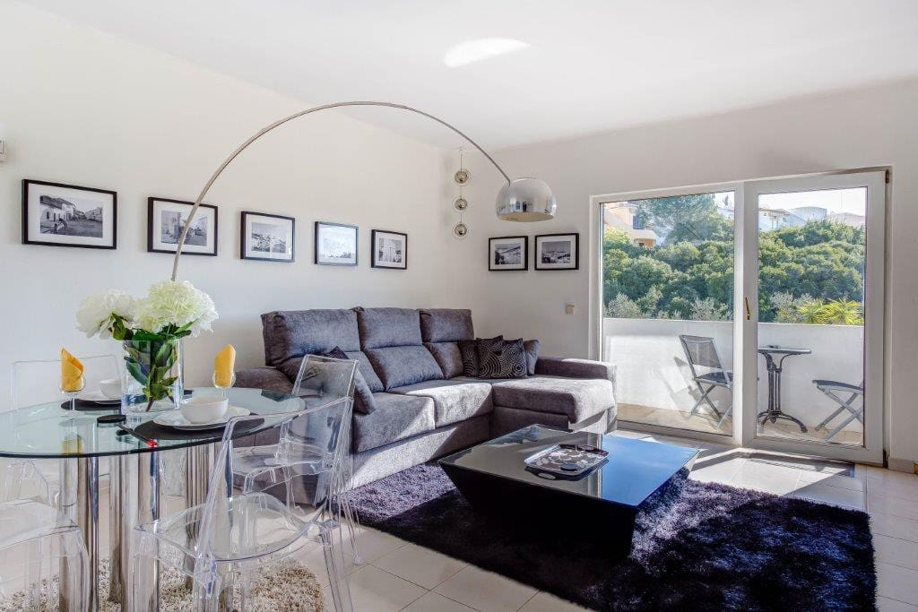 The contemporary bright lounge area leading to your private balcony