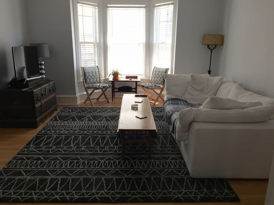 living room with large HD Smart TV and sound bar
